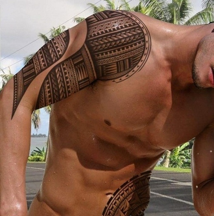 Tribal Tattoos On Arm And Ribs photo - 3