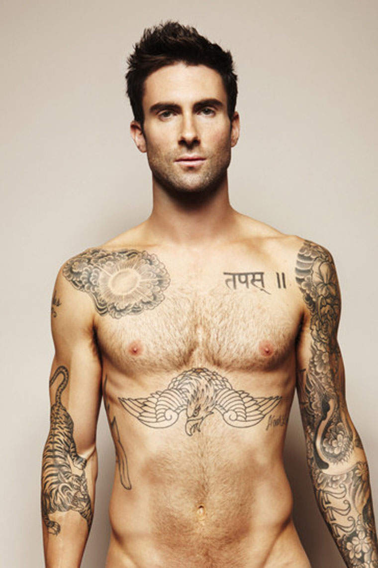 Tribal Tattoos On Chest And Arms photo - 3