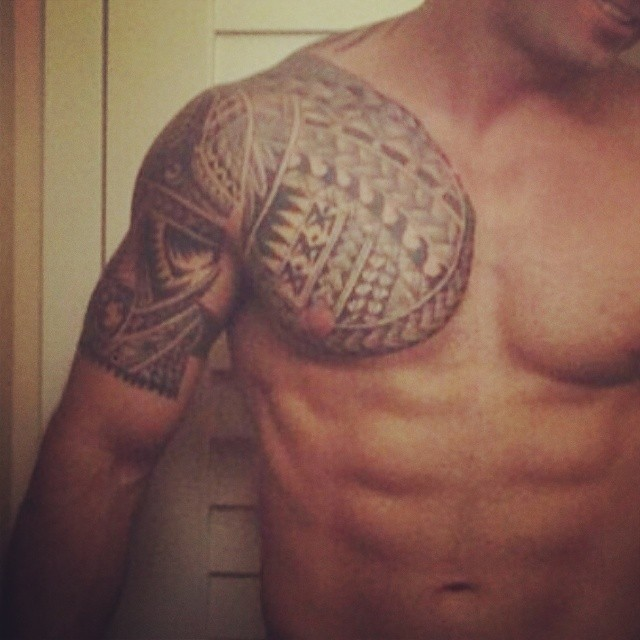 Tribal Tattoos On Shoulder And Chest photo - 1