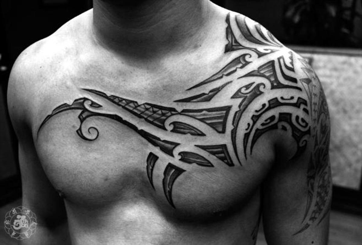 Tribal Tattoos On Shoulder And Chest photo - 2