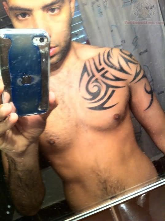 Tribal Tattoos On Shoulder And Chest photo - 3