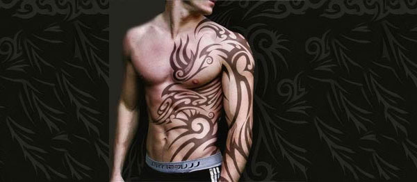 Tribal Warrior Tattoos On Chest And Upper Arm photo - 2