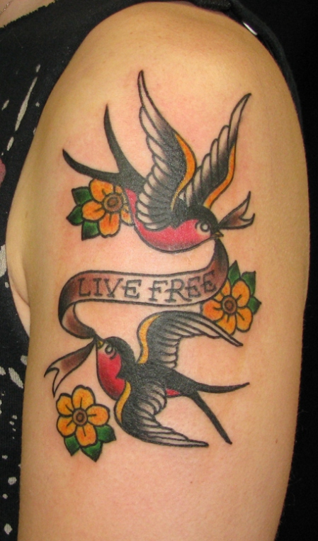 Two Sparrows Carrying A Banner That Reads Live Free Tattoo Design photo - 1
