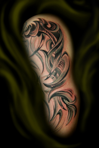 Upper Arm Black Ink Tribal Tattoo For Men photo - 3